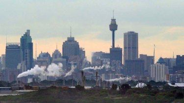 On a cloudy day ... industrial sites in Botany and Meadowbank, with the cityscape as a backdrop.
