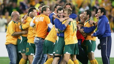 Off to the World Cup: Socceroos celebrate after winning the second leg of the 2006 FIFA World Cup qualifying match between Australia and Uruguay.