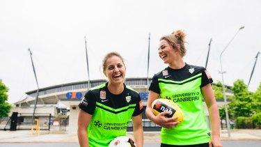 Canberra United players Ellie Brush and Jenna McCormick outside Canberra Stadium.