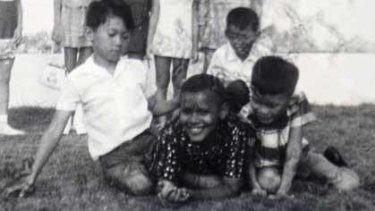 Happier days ... Barack Obama, centre, aged about 10 and then known as Barry Soetoro, at a classmate's birthday party in Jakarta in 1971.