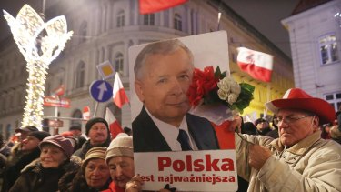 Supporters of the ruling Law and Justice party with a portrait of the leader Jaroslaw Kaczynski.