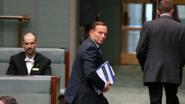 Prime Minister Tony Abbott departs question time on Wednesday.