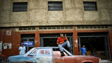Luis Jose Alfonso Gonzalez sits on his 1978 Chevrolet Malibu V8 in Naiguat, a small coast town near Caracas.