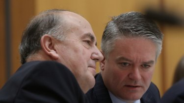 Treasury secretary John Fraser and Finance Minister Mathias Cormann during estimates at Parliament House.