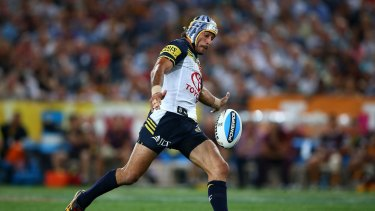 The moment: Johnathan Thurston on his way to nailing the match-winning field goal in golden point extra time.