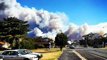 Smoke climbs from a fire burning just kilometres from homes at Bicheno, 150km north-east of Hobart.
