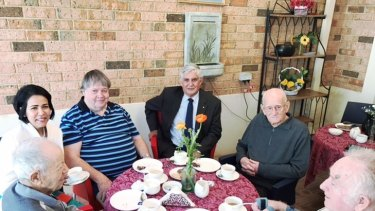 Aged Care Minister Ken Wyatt meets residents at a facility.