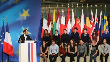 Students assemble to hear Emmanuel Macron's vision for a stronger Europe, with a joint budget for countries sharing the euro currency and a stronger global voice despite Brexit looming.