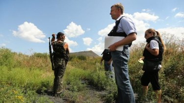 Deputy head of the OSCE mission, Alexander Hug, with pro-Russian rebel Yuri at the crash site.