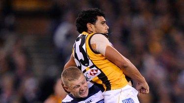 Cat Taylor Hunt gives Hawk Cyril Rioli a lift at the MCG last night.