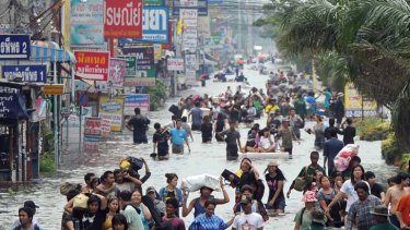 Hard hit ... Thai factory workers evacuate the area of Nava Nakhorn industry estate in Pathum Thani province, Bangkok.