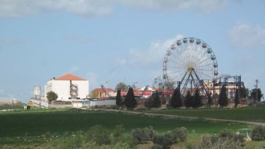Road to Nazareth ... the hand-made ferris wheel of Jenin tourist park rises above the West Bank.