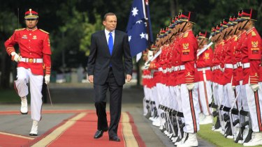PM Tony Abbott, on his first overseas visit as Prime Minister, inspects the honour guard in Jakarta, Indonesia.