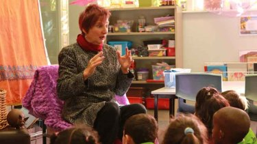 Julie Perrin tells a story to prep students at Coolaroo South Primary School.