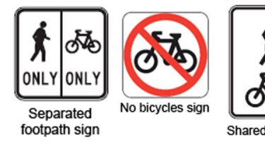 Signs indicating Queensland's bicycle rules.