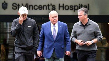 Steve Waugh and Alan Jones leave St Vincent's Hospital follow the death of Australian batsmen Phillip Hughes.