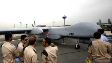 Israeli soldiers look at an IAI Eitan, also known as the Heron TP, surveillance unmanned air vehicle.