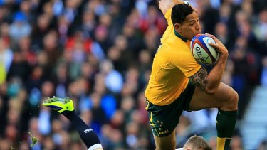 Israel Folau of Australia skips out of tackle from Chris Ashton in the lead up to Matt Toomua's try.