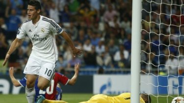 Rout: Colombia's World Cup hero James Rodriguez was in the thick of defending champions Real Madrid's 5-1 hiding of FC Basel.