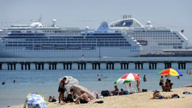 Rising heat  ... beachgoers at South Melbourne today.
