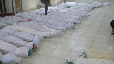 Counting the dead ... more than 100 people, including at least 32 children, were massacred in the town of Houla.