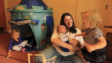 Worried about infection: Fenella Cios, director of Fenella's Family Daycare, with Ellie Graf, 2, nine-week-old son Oliver and Victoria Dale, 18 months.