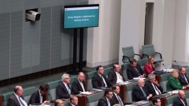 New screens on the floor of the House of Representatives display Prime Minister Tony Abbott's statement on national security on Monday. Photo: Andrew Meares
