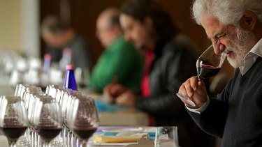 A good drop ... South African wine expert Michael Fridjhon tests the cabernet range of wines at the challenge.