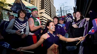 Fremantle Dockers supporters arrive at Southern Cross bus terminal