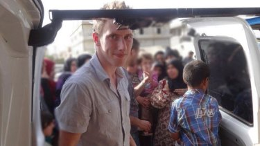The militants continue to hold three hostages, including  Peter Kassig, an emergency medical technician from Indiana. They say they will kill him next.