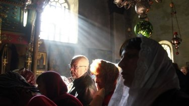 Worshippers in the Church of the Nativity, Bethlehem.