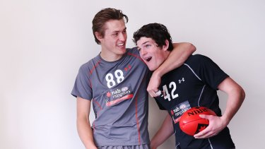Brayshaw with Darcy Moore.