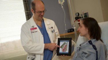 Pioneering: Dr Henry Feldman of Harvard Medical School demonstrates the uses of iPad technology.
