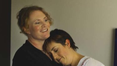 Fighting for job ... Captain Bridget Clinch and wife Tammy at their Brisbane home.
