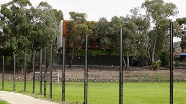 The large fence along Alphington Grammar on the Darebin Yarra Trail.