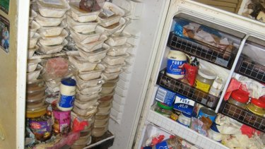 Meal on Wheels containers piled up in the fridge of a 79-year-old Caulfield woman.