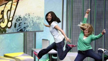 """Gamers demonstrate the game """"Kinect Adventures"""" for Kinect for Xbox 360."""