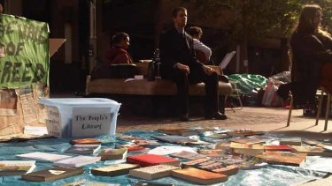 People have donated books to the campsite at Martin Place.