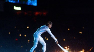 Australian Olympic athlete Cathy Freeman ignites the Olympic flame during the opening ceremony for the Summer Olympics.