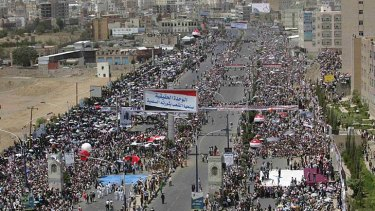 Anti-government protesters attend a ceremony in Sanaa commemorating the anniversary of Yemen's reunification.