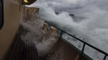 Wild start to the week: commuters on the Manly ferry had a bumpy ride to work.