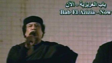 Public appearance ... Muammar Gaddafi addresses his supporters.