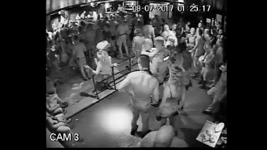 A policeman dancing with a woman at Inflation nightclub, shortly before a shooting that is under investigation.