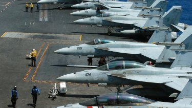A US Navy aircraft carrier prepares for patrols in the South China Sea in early march.