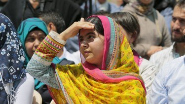 Nobel Peace Prize laureate Malala Yousafzai shades her eyes against the sun at a school for Syrian refugee girls, built by the NGO Kayany Foundation, in Lebanon's Bekaa Valley on July 12, 2015.