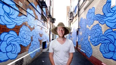 """Job done ... Jason Wing has painted murals, etched designs into the paving and suspended metallic """"spirit figures"""" in Kimber Lane."""