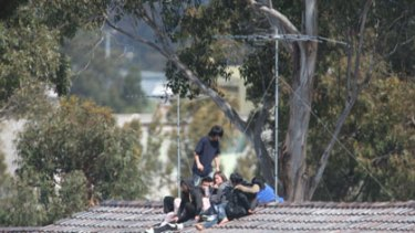 Warning ... Chinese detainees, including a pregnant woman, yesterday threatened to jump off a roof at the Villawood centre.