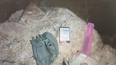 Photographs from the scene of a shooting, obtained by the ABC, show the contents of the pockets of an Afghan boy named as Khan Mohhamed from an ABC News report. Supplied