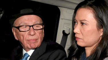Rupert Murdoch looks to his wife, Wendi Deng Murdoch, as they are driven from The Leveson Inquiry in 2012.