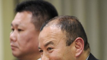 The new head coach of Japan's national rugby team Eddie Jones (R) speaks before press in Tokyo on December 26, 2011, while new assistant coach Masahiro Kunda (L) looks on.